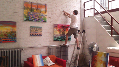 Bevan installing paintings in his studio for the May 2015 open studio day.