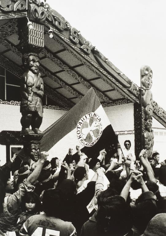 Hanly, Gil. A Moment of unity before leaving Te Puea Marae. 1984. Black and white photograph. Auckland Art Gallery Toi o Tamaki, purchased 1986, Auckland.