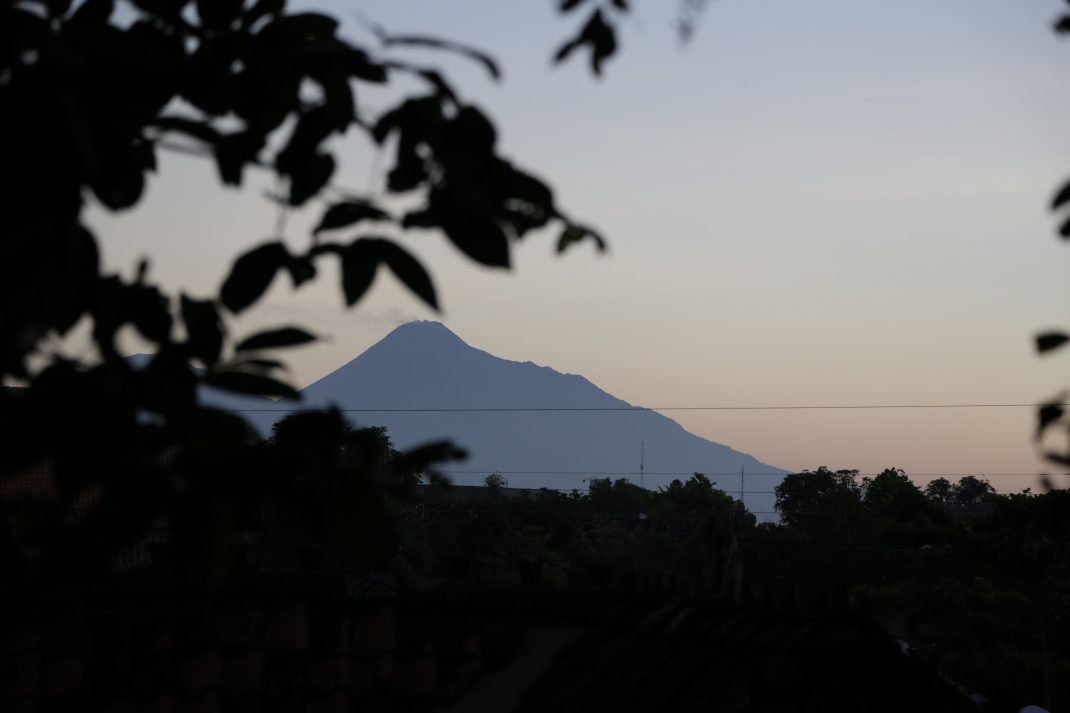 Mt Merapi, an active volcano visible in the distance from Chong's living quarters at Cemeti Art House.